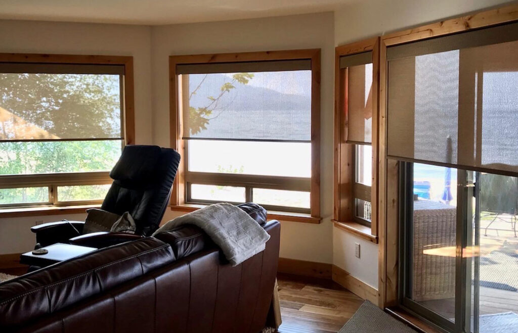 designer screen shades on living room windows and sliding doors in Incline Village NV