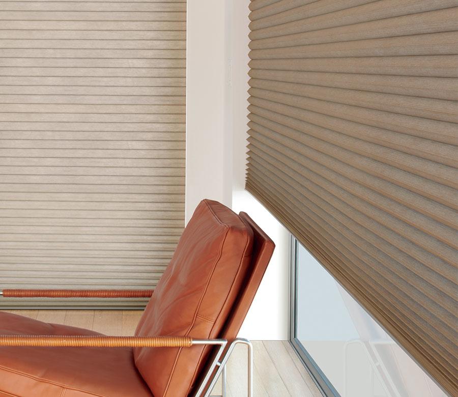 beige honeycomb shades on corner windows in Reno NV