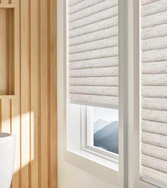 sonnette cellular roller shades create insulating barrier in Reno NV bathroom