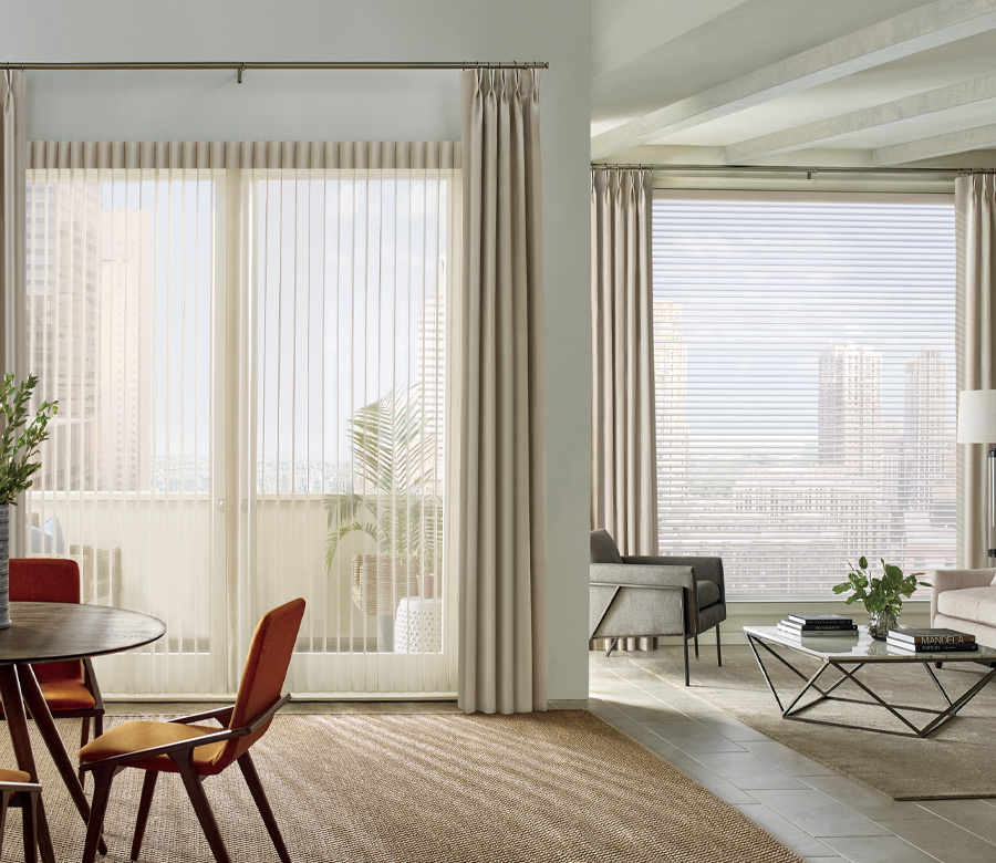 floor to ceiling windows with sheer vertical shades and draperies in Reno NV