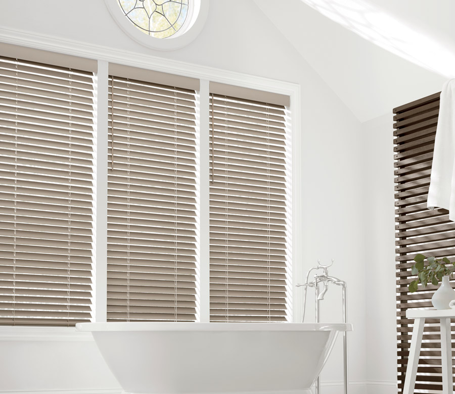 bathroom with tall windows neutral faux wood blinds in Reno NV home