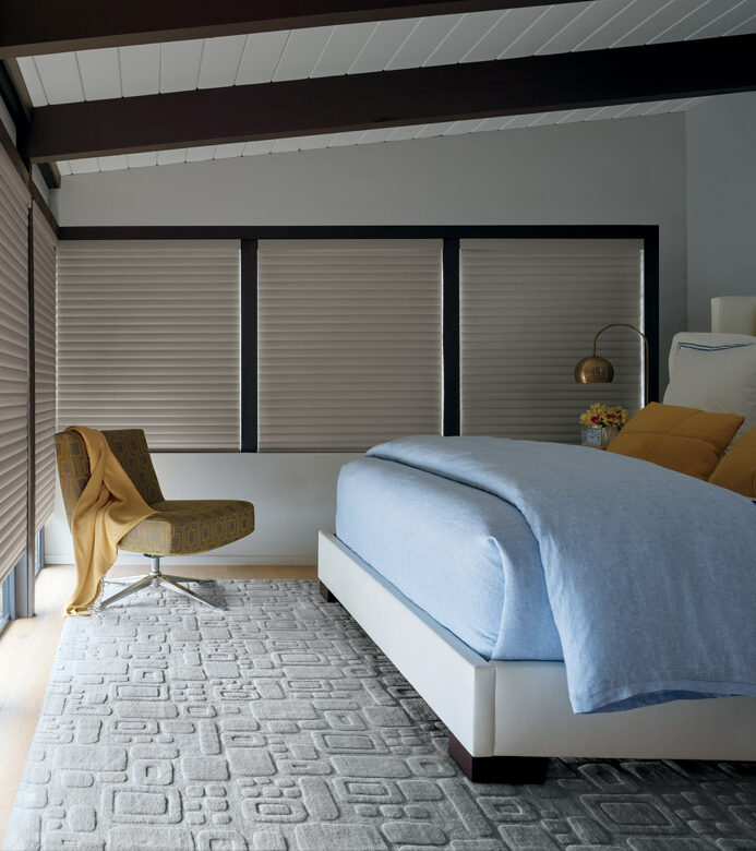 master bedroom with large windows covered with room darkening cellular roller shades in Reno NV