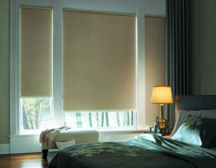 Room darkening roller shades in bedroom.
