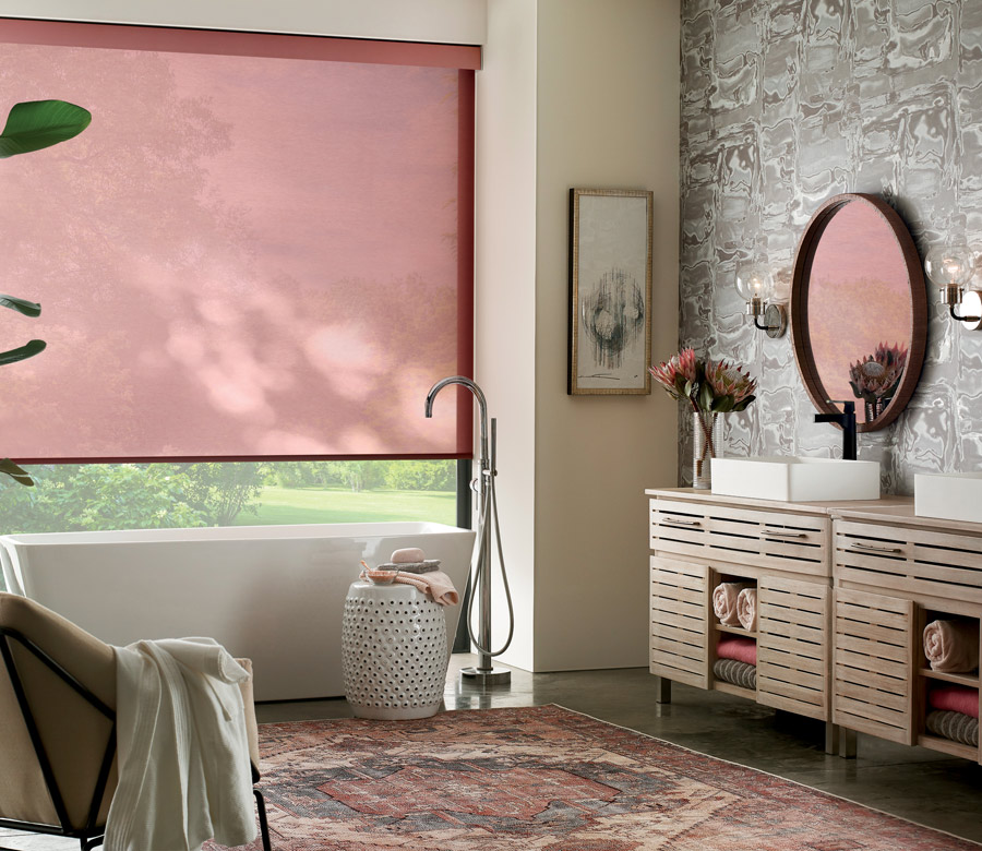 Red designer roller shades in bedroom of Reno area home