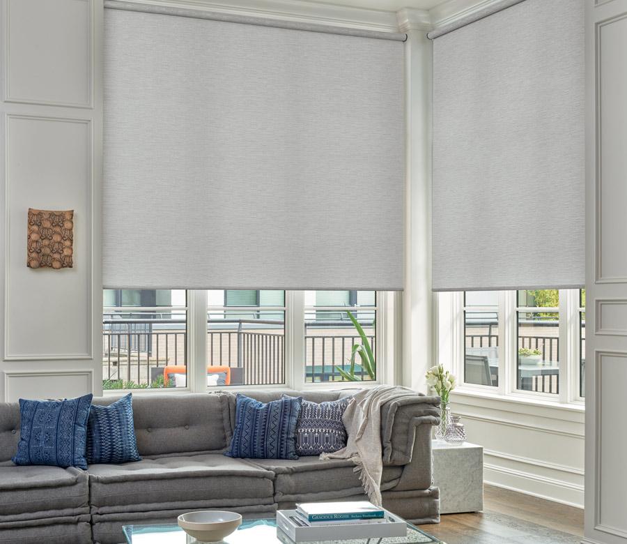 Large corner window In Reno NV living room with designer roller shades