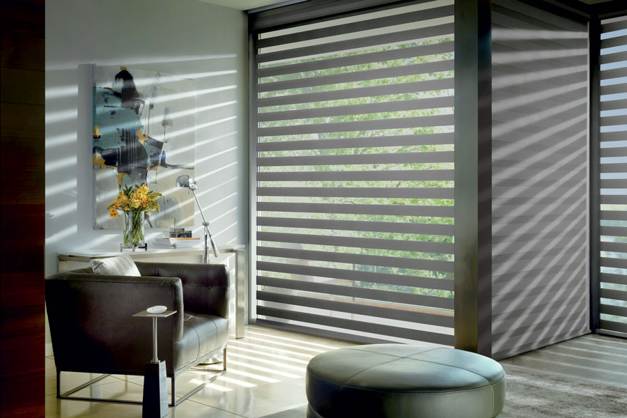 Banded roller shades on floor to ceiling windows for balanced light in Reno, NV