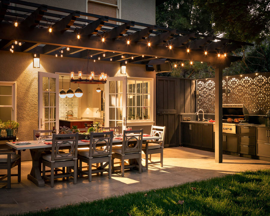 Outdoor patio with dining table and lights