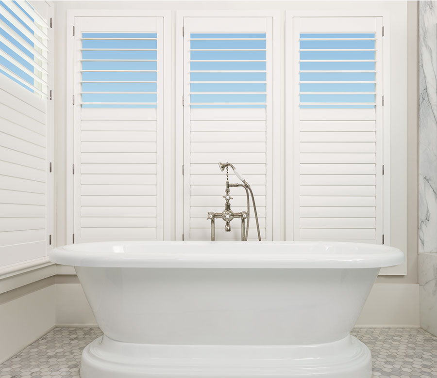 Bathroom view of top down feature shutters in bathroom of Reno home