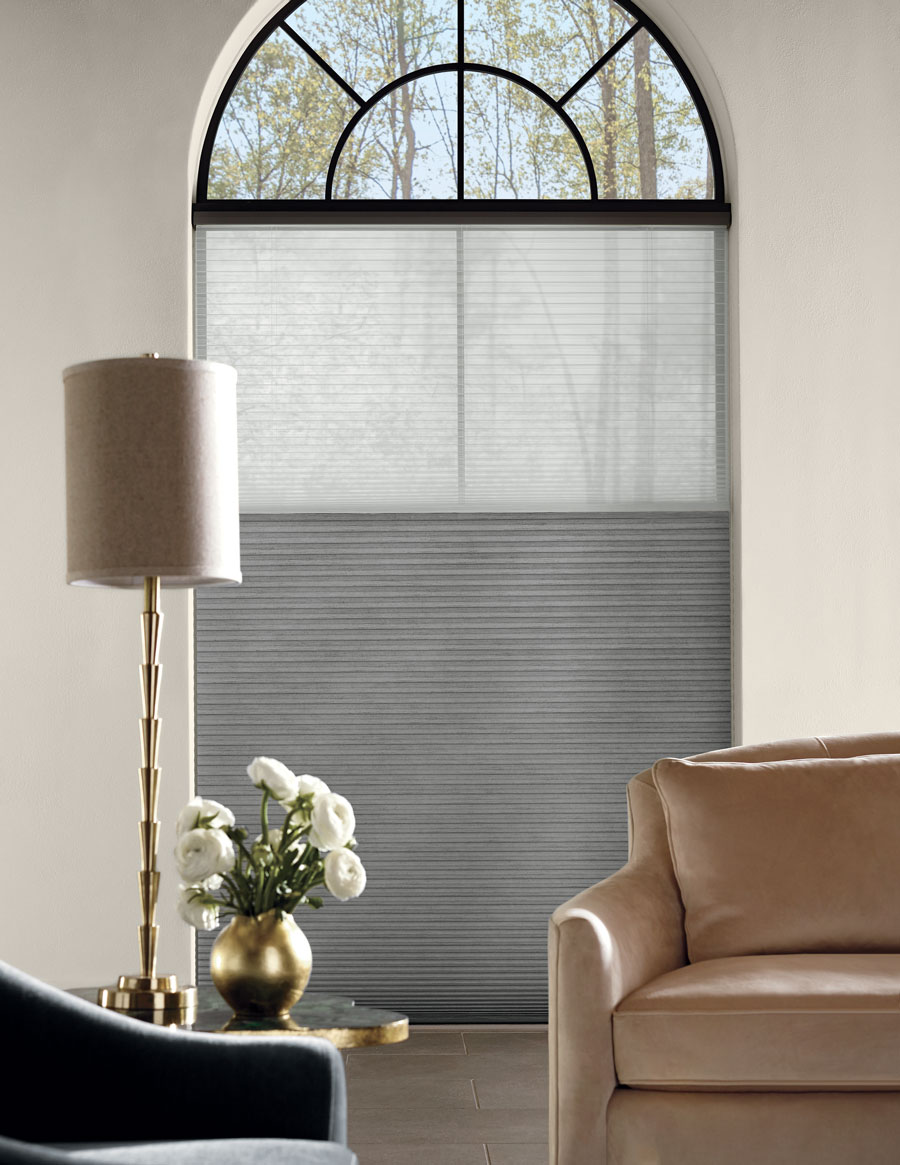 tricky arched window with honeycomb shades in Reno NV living room