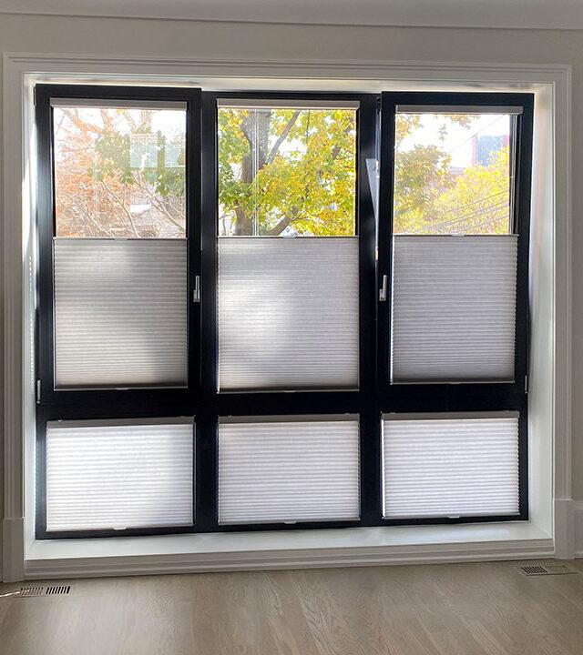 dark framed tilt turn windows covered with honeycomb shades in Reno NV