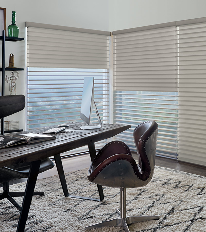 neutral office with floor to ceiling shades