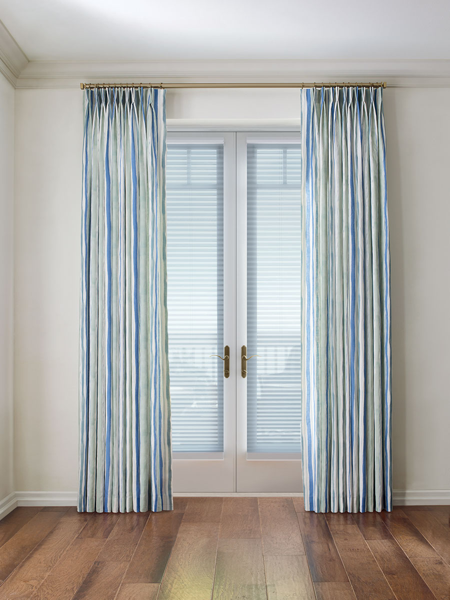 blue draperies over honeycomb shades on french doors in Incline Village NV
