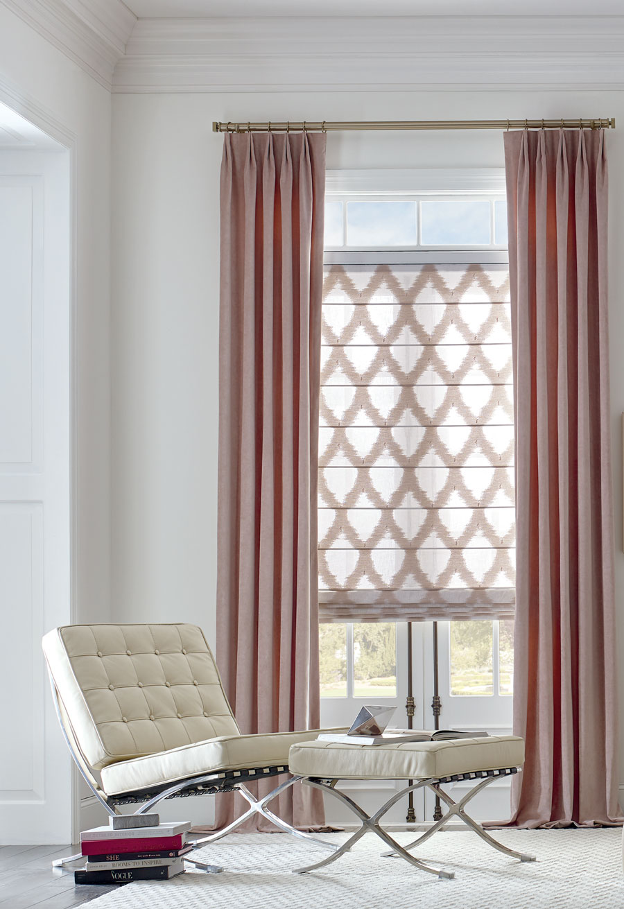 rose color drapery and pink patterned roman shades in these fabrics enhance