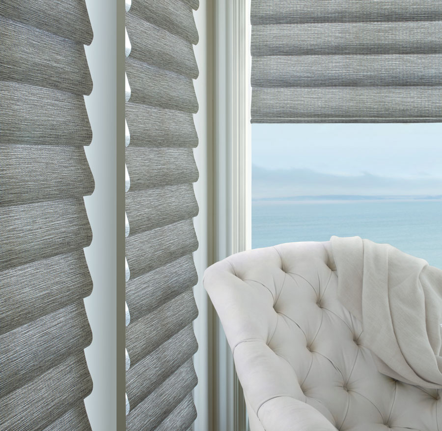 Large window treatments in silvery gray in corner windows