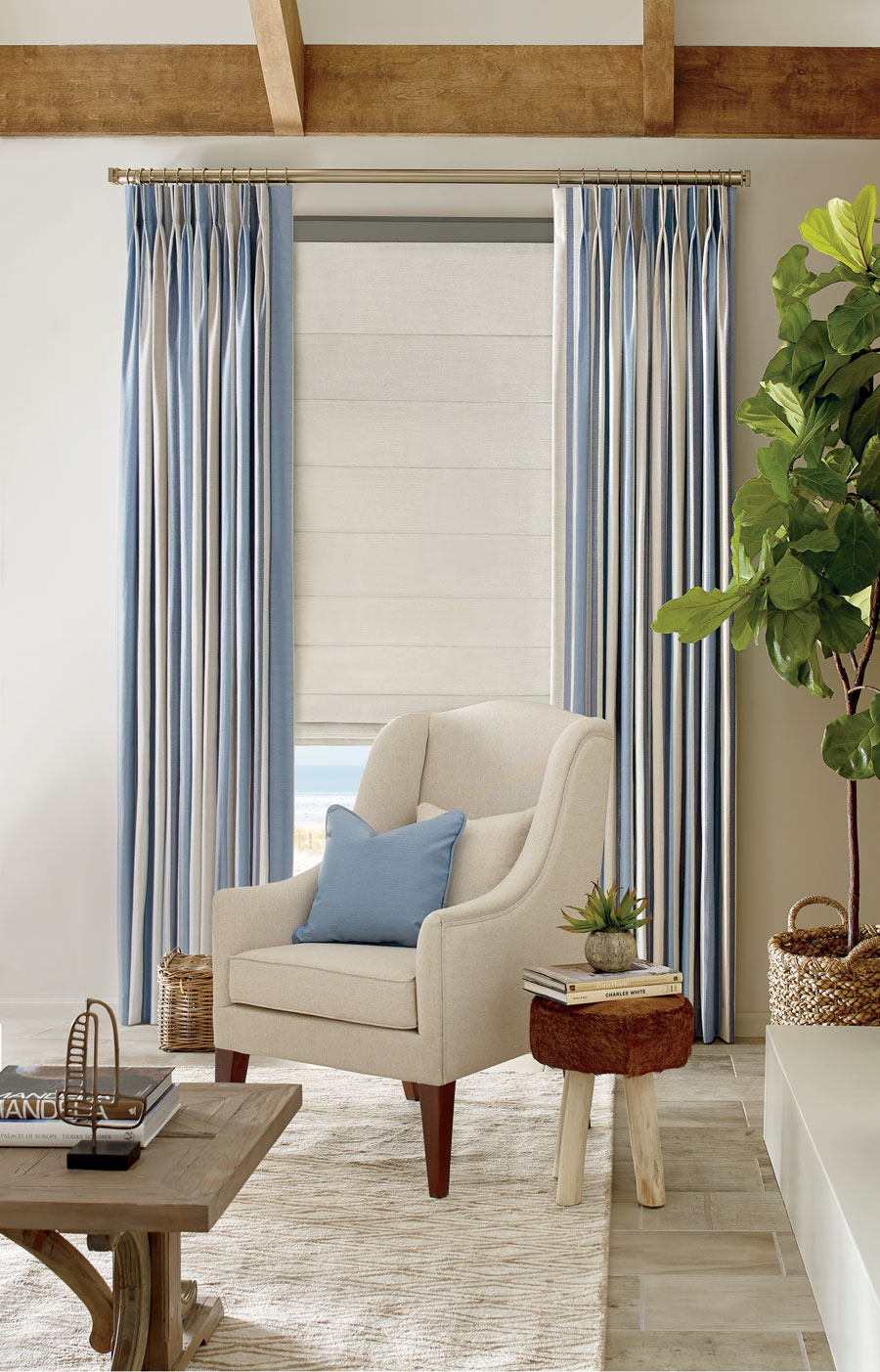 blue striped fabric drapery and coastal inspired white roller shades in Reno, NV