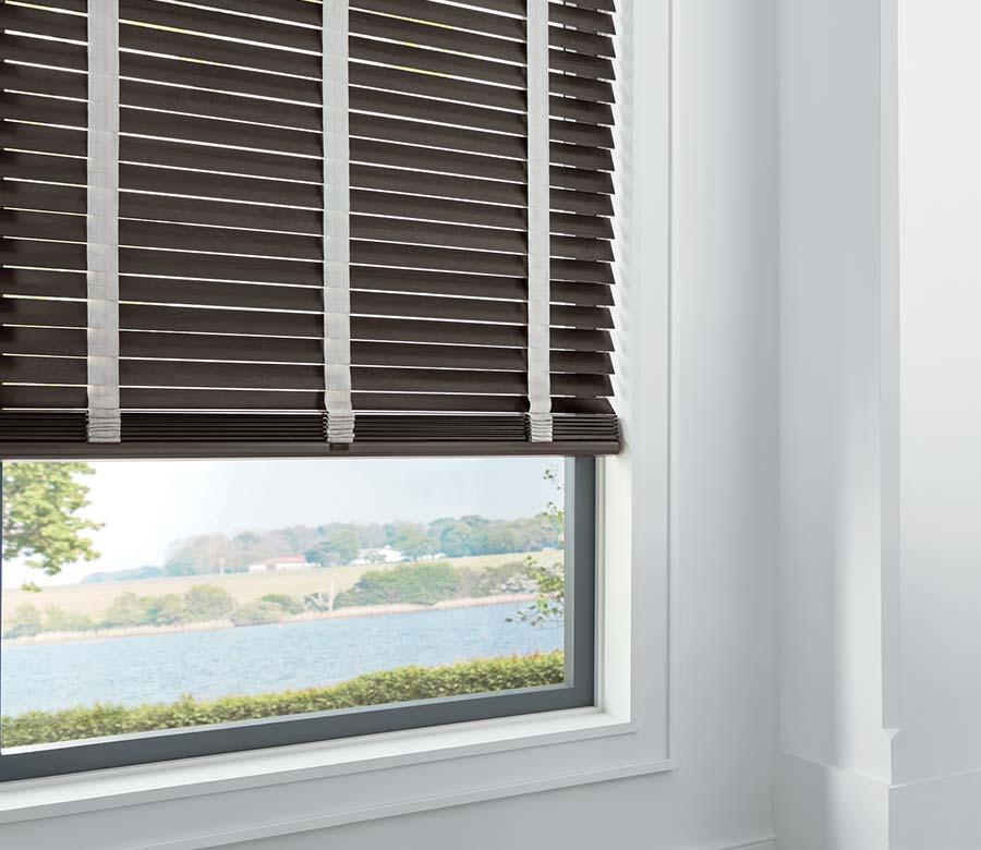 brown wood blinds overlooking reno river